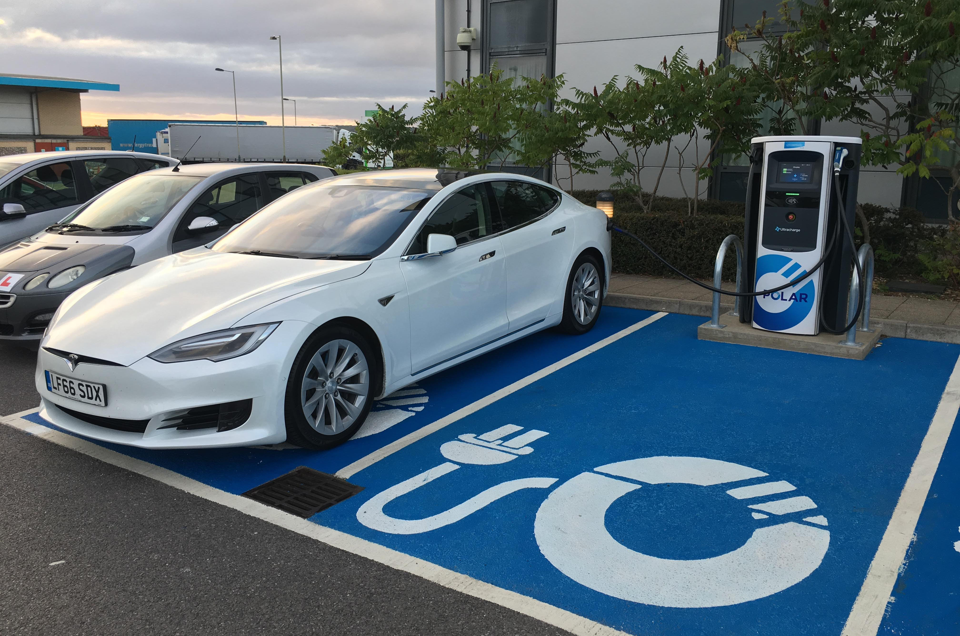 A Tesla Model S charges at the Chargemaster Polar unit at Solstice Park, Wiltshire