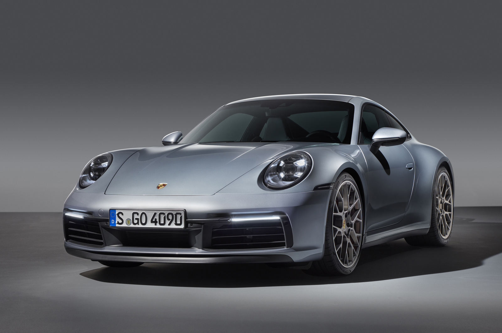 Porsche reveals new 911, the 992 Carrera, and hints of a hybrid